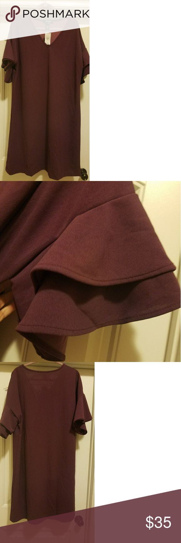 Plum colored dress This beautiful plum colored dressed can be worn anywhere. It is very nice in not showing your stomach. Ashley Stewart Dresses Midi