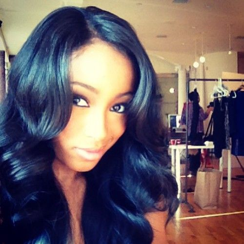 layered sew in hairstyle
