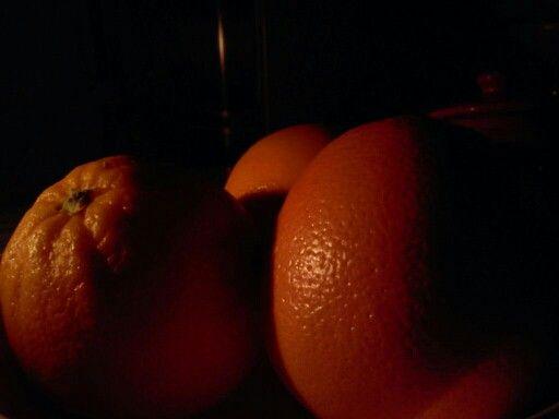 oranges in dark