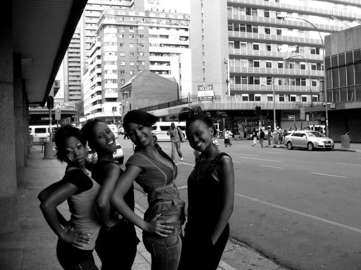 A group of girls poses for the camera.