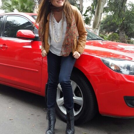 Rouge. White blouse, printed scarf, brown coat, blue jeans, black boots, pearls, casual outfit