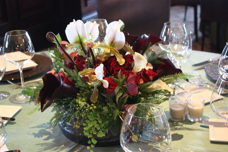 Stunning Lady Slipper orchids, black mini calla lilies, roses and maidenhair fern...