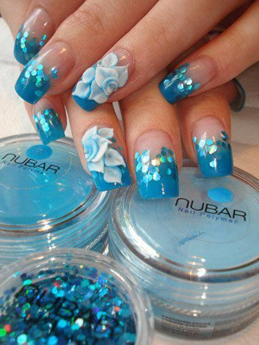 Turquoise blue french tips with matching glitter and white one-stroke technique flower accent nails, floral, free-hand nail art   30 Nail Designs That We Love