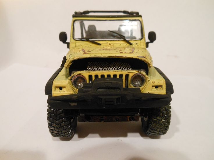 The Jeep Wrangler has been around for a long time. This one has four wheel drive and huge tires. The chassis is weathered with mud and rust as well as age, The model came without a engine so I cut open the hood and placed a spare engine in there. The paint is pitted, scratched and rotted. Its a cool ride and the yellow color is bright. It measures 5 inches long and three inches high. Its 1/24 scale made from a plastic model kit