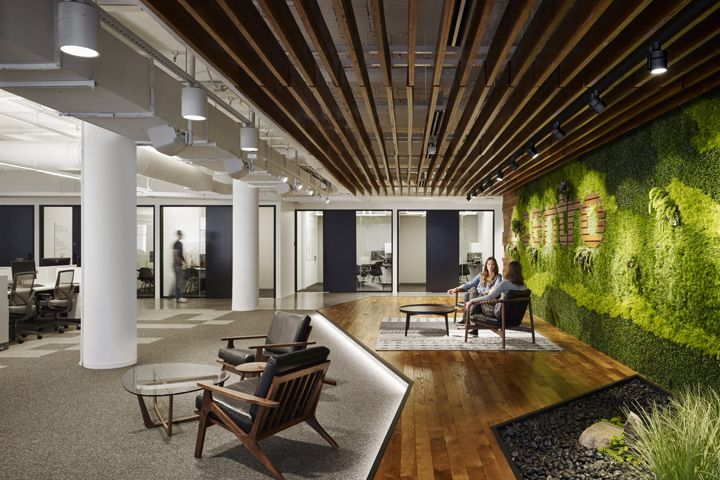 Key materials such as a greenery, wood, steel and concrete were used to form elegant and sophisticated tech-centric office space: I like this for acoustically sensitive areas such as a medical clinic reception lobby