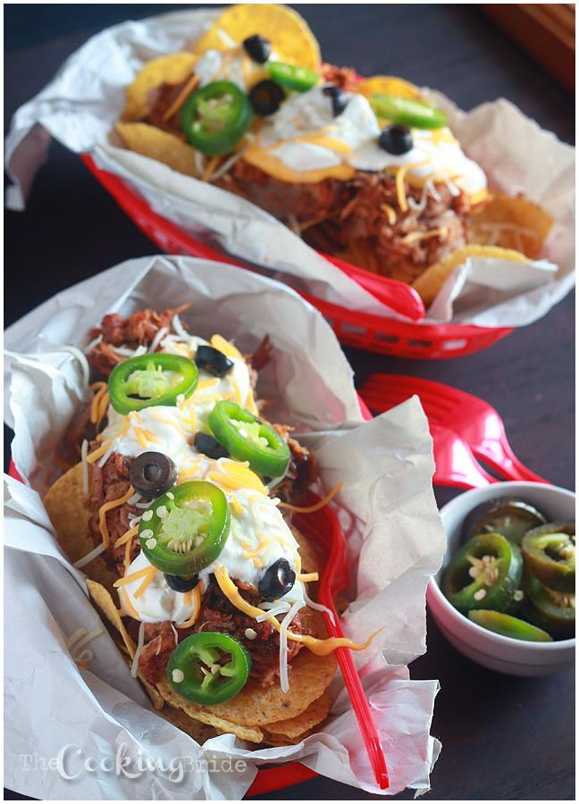 Nothing says Game Day like a heaping plate of nachos. Turn your Game Day fare up a notch with this recipe for Barbecue Pulled Pork Nachos. Slow cooked pulled pork is piled high on tortilla chips and then topped with creamy homemade cheese sauce.
