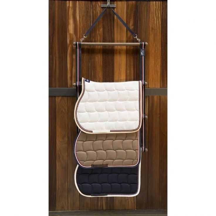 ANNA SCARPATI LUXURY WOODEN SADDLE PAD HANGER As well as being extremely useful, this Anna Scarpati hanger also looks both smart and stylish, adding a classy look to your stables, tack room and helps you to stay organized at the shows. This saddle pad Hanger is elegant and practical as well as keeps rugs, saddle cloths neat, clean and organised.