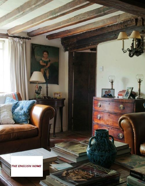 Leather chesterfield, art, bow front chest, books everywhere -beautiful English style