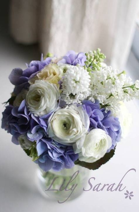 Purple hydrangea bouquet with lilac and ranunculus