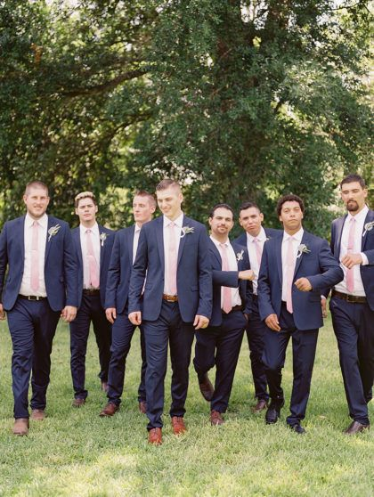 Brandon and his groomsmen looked dapper in their navy suits paired with blush pink ties. Photo: Kate Anfinson Photography | Venue: Barr-Mansion | Florist: Lovely Leaves Floral Design #austinwedding #bridesofaustin #groomsofaustin