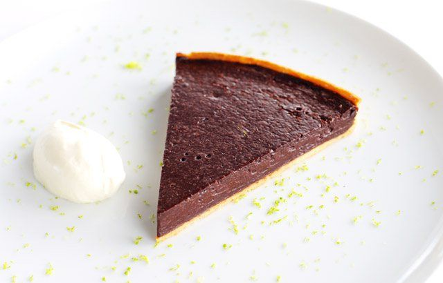 Chocolate and chilli tart with crème fraîche and lime by Robert Thompson
