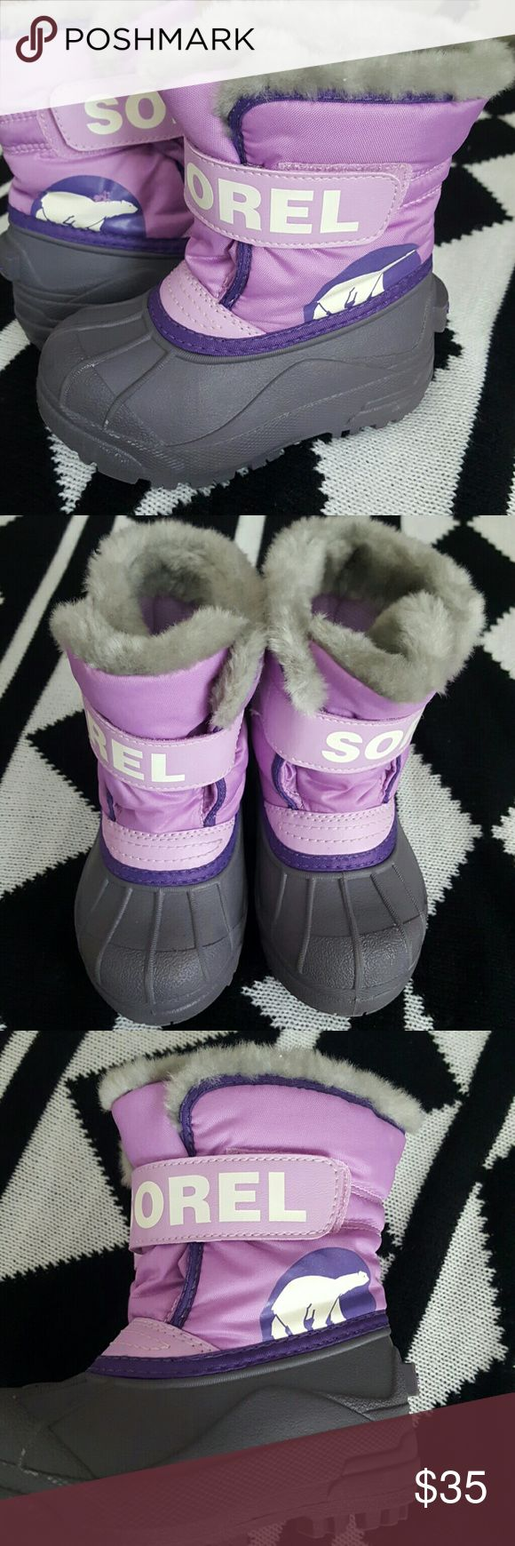 Kids Sorel snow boots Darling child's Sorel snow boots. Used maybe once. Perfect condition.  My little girl skipped size 8. Sorel Shoes Boots