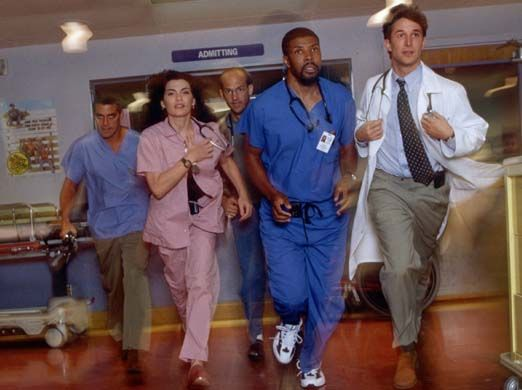 Credit: Sven Arnstein/NBC/AP Members of the cast of ER, from left, George Clooney, Julianna Margulies, Anthony Edwards, Eriq La Salle and Noah Wyle rush through an emergency room set during a rehearsal for the show in 1997. Michael Crichton drew on his own medical experience to create the show