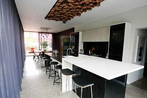 Best of 'The Block' Australia - Alisa + Lysandra's challenge room kitchen. DIY timber ceiling light fixture.