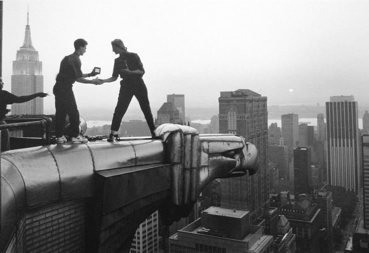 Annie Leibovitz and assistant Robert Bean on the Chrysler Building, New York, NY, 1991