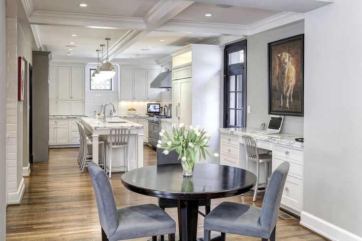 This kitchen features ample seating for a casual breakfast or lunch, whether you choose the table or island bar stools.