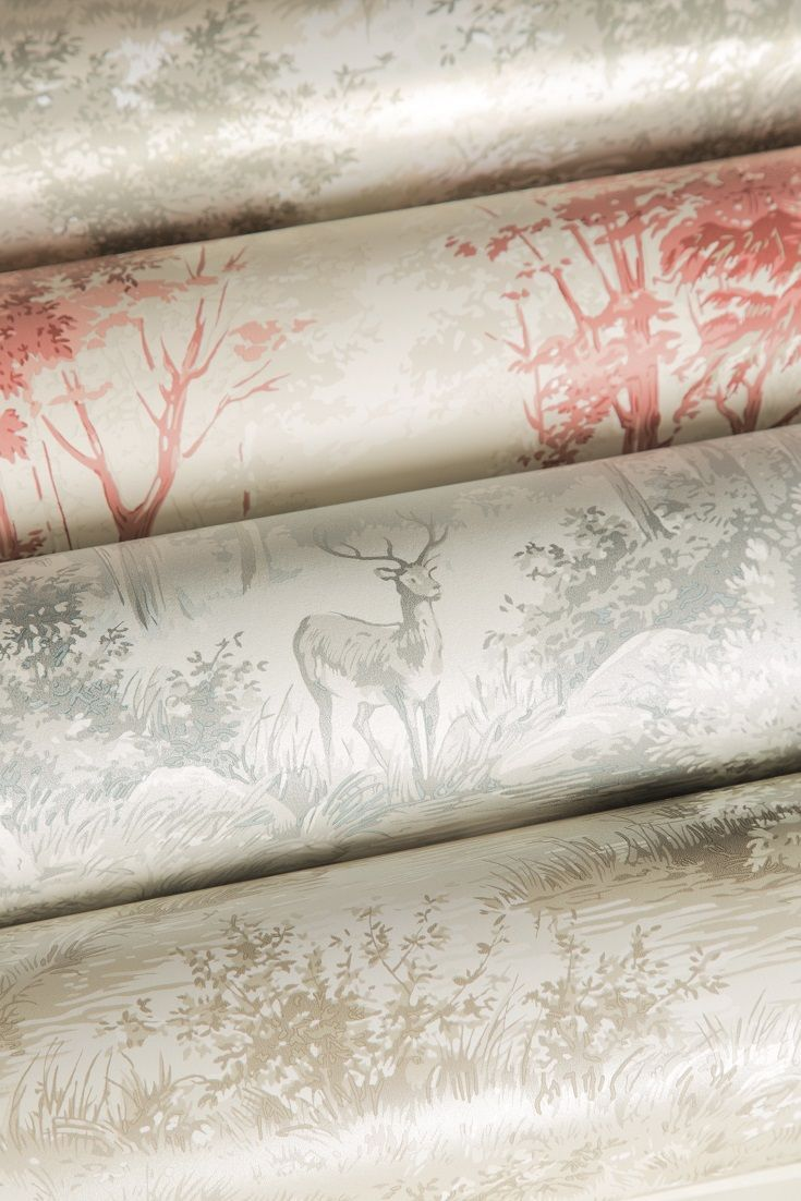 This charming wallpaper pattern by Mulberry features a scene of a woodland glade with deer.