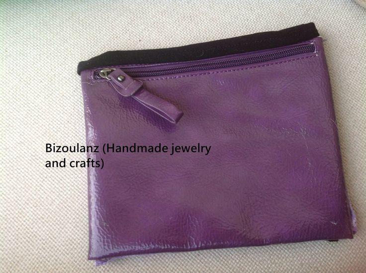 It's a purple and black envelope purse