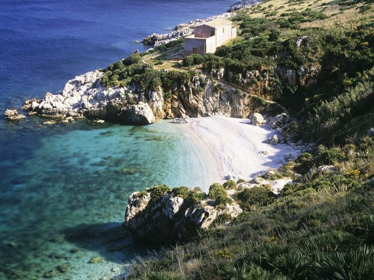 CALA MARINELLA Sicily dominates any list of beautiful Italian beaches and it's not hard to see why. Cala Marinella is yet another secluded white sand cove nestled into low cliffs, in a peaceful nature preserve in the Gulf of Castellammare.