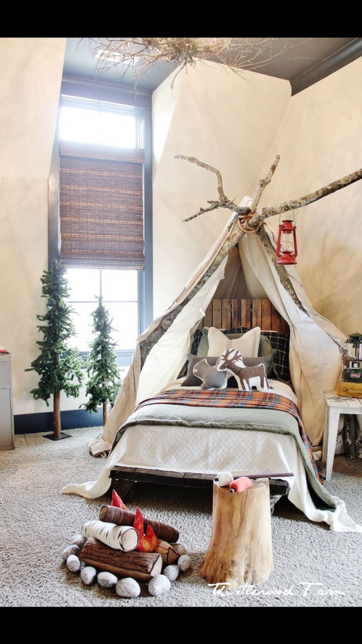 I want the fake trees, the fake campfire, the wooden frame around the bed and everything else in this room!
