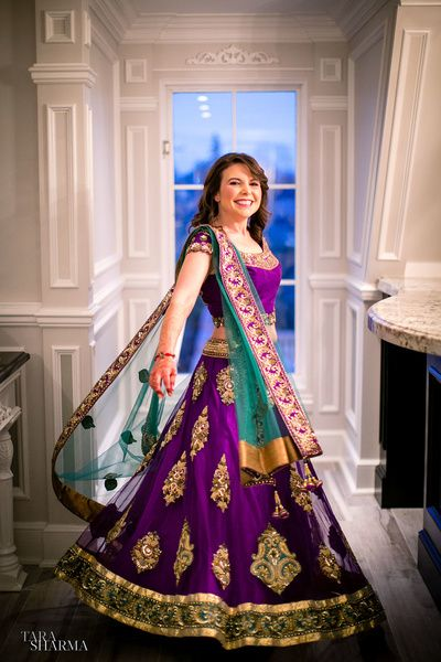 Sangeet Lehengas - Purple and Teal Lehenga | WedMeGood Purple Lehenga with Gold Zari teal work with Gold border #wedmegood #teal #purple #lehenga