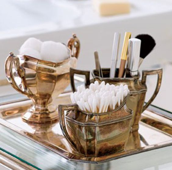 Use ordinary objects as bathroom accessories like these cooper urns. Perfect to hold those essentials and to keep them at hand.