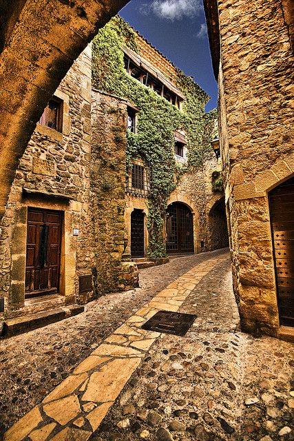 This is a picture a Medieval time in Pals, Girona, Spain. Their homes where made out of stone and the buildings they lived in where more like apartments instead of separate houses. So people lived pretty close together. These where nice buildings.