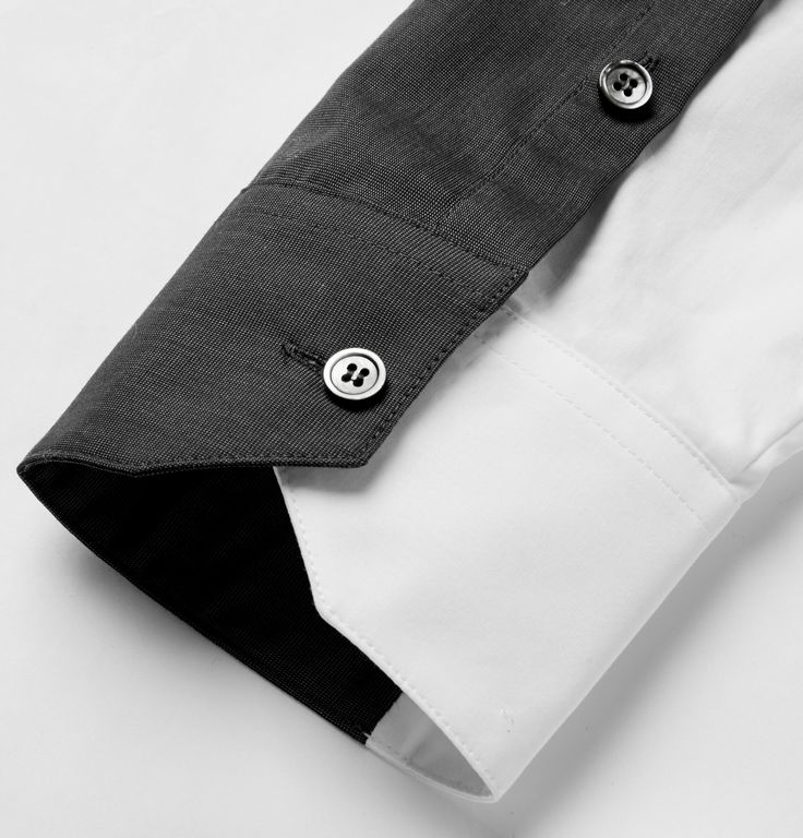 South Korean brand Wooyoungmi is known for its fine attention to detail and architectural cuts. A case in point is this panelled cotton shirt, which features a two-tone spread collar giving it a layered appearance. Wear this slim-fit design with sharp contemporary tailoring and athletic footwear.