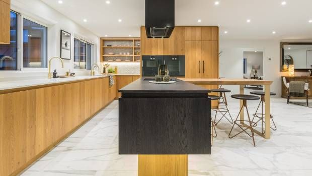 The new award-winning kitchen, by Auckland designer Natalie Du Bois, features dark-stained and natural oak cabinets. The ...