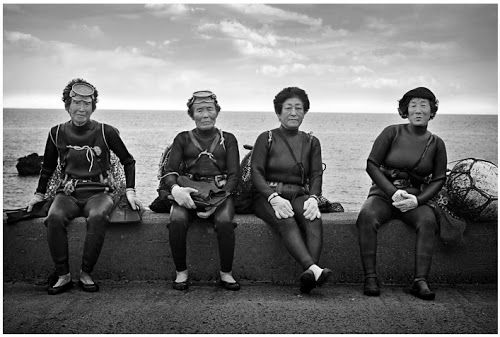 """The Haenyo, or """"sea women"""" are female divers from Jeju Island, an island off the coast of South Korea. Sometimes referred to as Korean Mermaids, these women can dive up to 20 meters and hold their breath for several minutes in search of octopus, conch, seaweed, and sea urchin. Equipped in nothing but a mask and wetsuit, no oxygen tank is needed for these women!"""