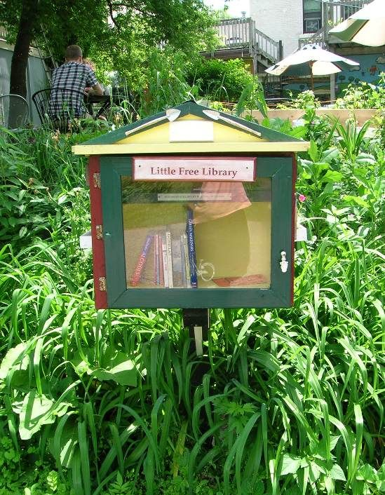 One of the Little Free Libraries in the U.S., designed to hold around 20 books, which runs on the honor system 'Take a Book, Leave a Book.'