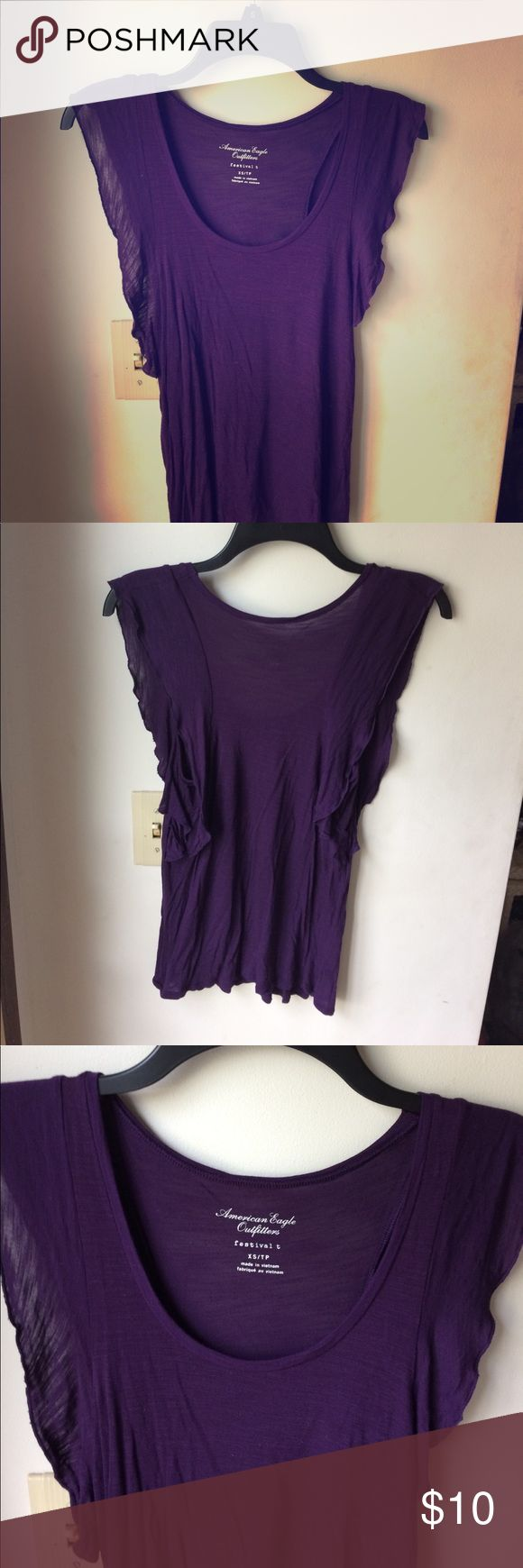 American eagle outfitters flutter top Xs plum colored top by American eagle outfitters. Has flutter sleeves that spice up this top. It is a slightly sheer material so possible bandeau underneath or a nude bra. American Eagle Outfitters Tops Tank Tops