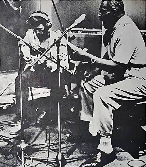 """Eric Clapton and Howlin' Wolf during """"The London Howlin' Wolf Sessions,"""" 1972."""