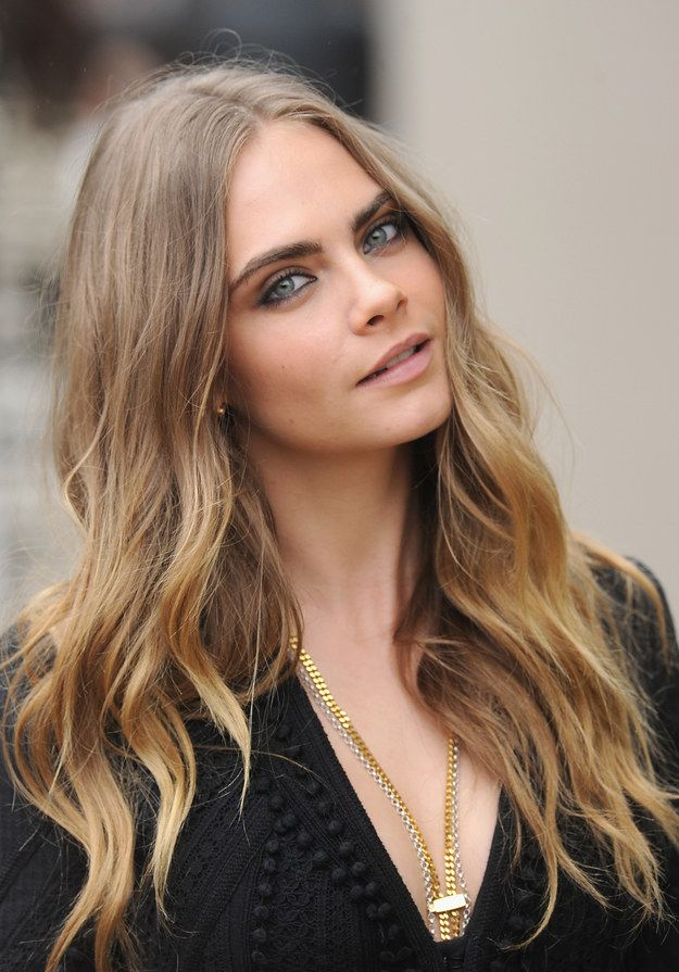 Everyone knows this is Cara Delevingne — a beautiful model and actress who also happens to be part of Taylor's royal squad.