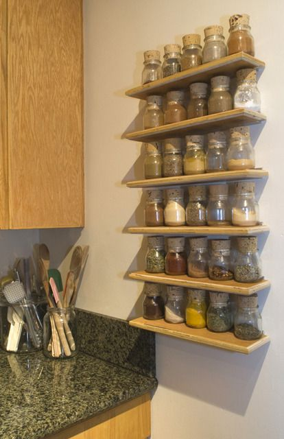 Natura Yogurt bottles + oversized corks = way nicer spice rack than mine #kitchen #diy #inspiration