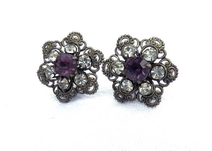 Filigree Metal Clip On Earrings, Faux Amethyst & Diamond Faceted Stones, Silver Tone Metal Costume Jewellery Circa 1950 Excellent Condition by BlackSquirrelHome on Etsy https://www.etsy.com/uk/listing/523081672/filigree-metal-clip-on-earrings-faux
