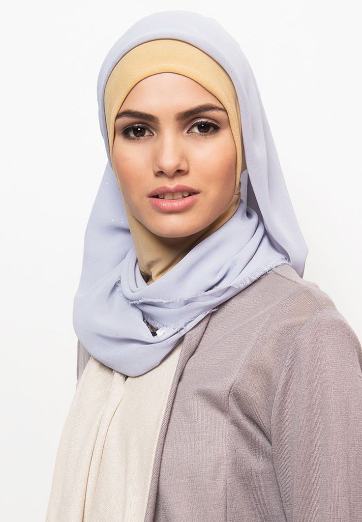 Ceruti Glitter Pashmina by ARTKEA. Wear this pashmina as your hijab, with a touch of glitter, fringe tip, this light gray color hijab will suit your modern style perfectly, length 108 cm, wide 108 cm. Pair it with a long cardigan with pastel color for a casual chic style. http://www.zocko.com/z/JHwz5