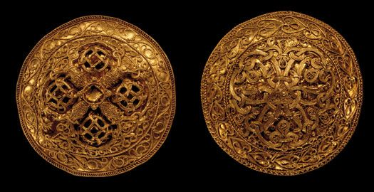 The hoard from Hornelund was found near Varde, and it contains two clothes brooches and an arm ring of gold. The two brooches are the finest from the Danish Viking Age. The relief of the brooches has been hammered out over a matrix. They are decorated with wire filigree and granulation. Their decoration with foliage and vine leaves has its origin in Christian art. The Norse animal heads on one brooch show that they were made by a Danish goldsmith in the last half of the tenth century.