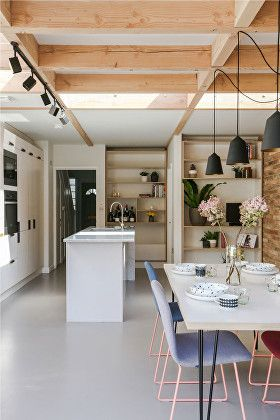 Contemporary kitchen extension to 1950s infill house in Peckham. High quality materials, with a distinctive, honest timbre. Exposed timber portal frames are in Douglas Fir that creates a warm, pink hue, the floor is poured concrete and an exposed wall of specially selected long bricks runs along one edge of the living space extending out into the garden. A restrained, simple palette is maintained with the translucent white plywood kitchen with wooden and marble worktops.