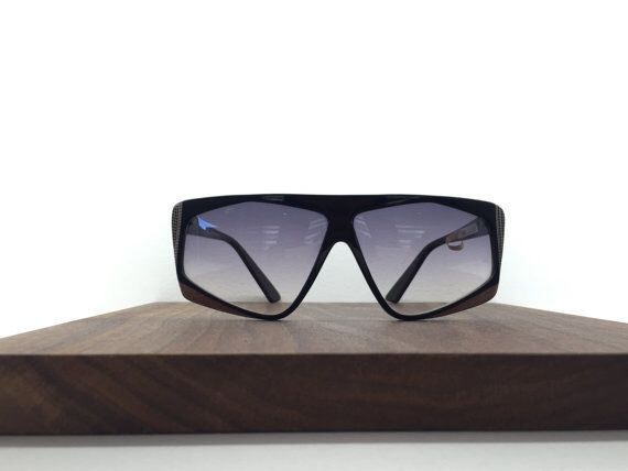 1980's Dama Style Black Checkered Sunglasses by Revue by blackandbluevintage on Etsy https://www.etsy.com/listing/223050777/1980s-dama-style-black-checkered