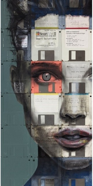 British artist, Nick Gentry, makes portraits used on floppy discs. First, he makes a canvas, and then he goes to work with oil paint.
