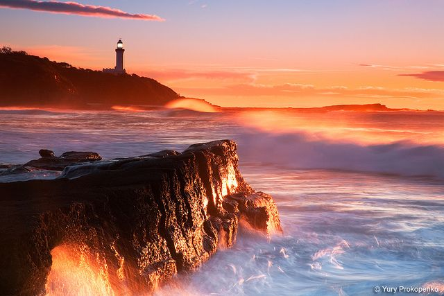 Sunrise at Soldiers Beach, Central Coast, NSW Australia Norah Head lighthouse in the distance