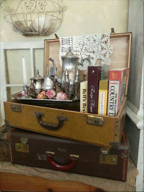 Vintage suitcases and silver tea set.
