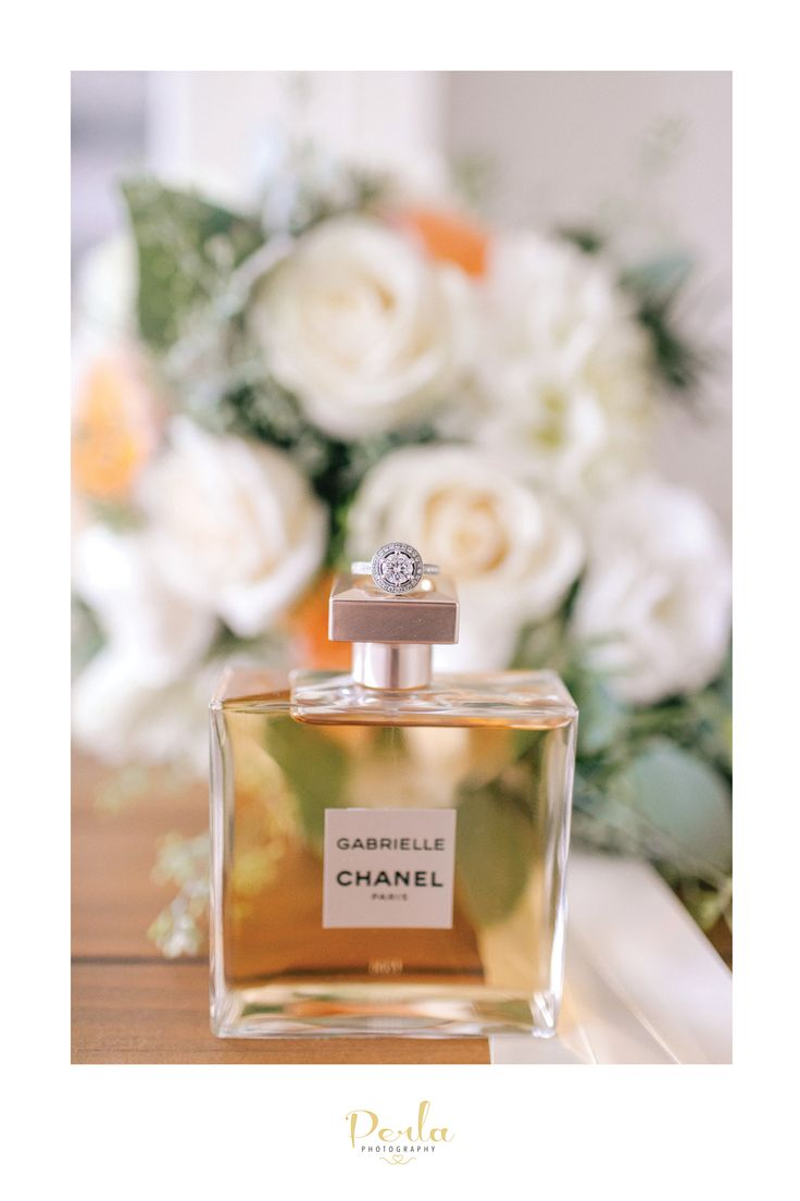 Chanel perfume and diamond engagement ring. Wedding details.