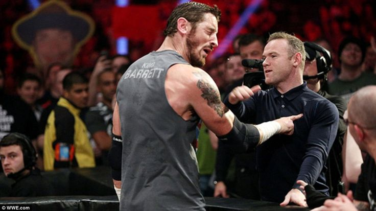 Wayne Rooney lands a theatrical slap on Wade Barrett after being called out by the wrestle...
