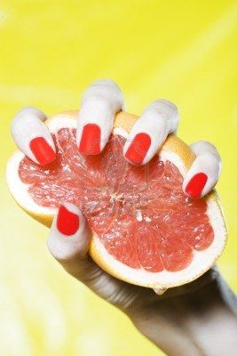 http://www.123rf.com/photo_3975591_woman-hand-with-red-nails-and-colorful-background-squeezing-grapefruit.html