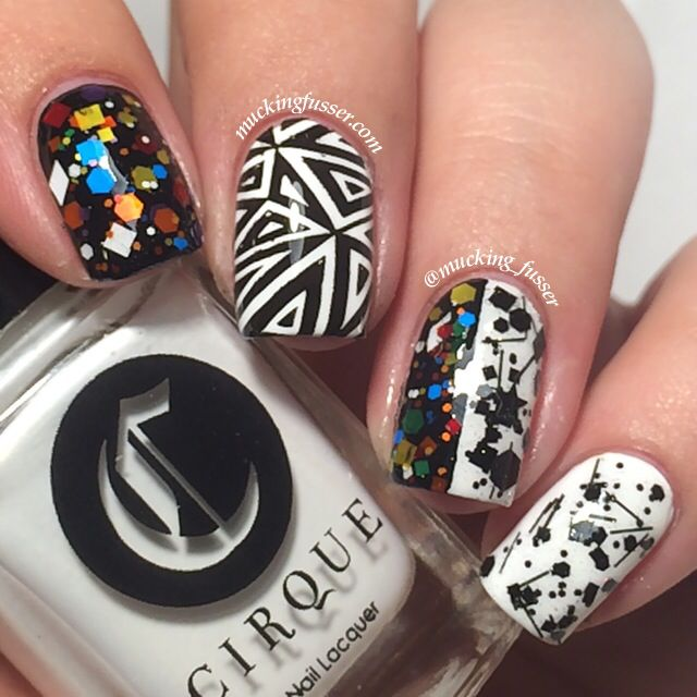 Cirque Colors KALEIDOSCOPE shown over black in a mix-n-match mani