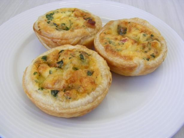 Mini Quiche. 1 ready-rolled shortcrust pastry 6 eggs 1 C cream 1 C grated cheese Salt & Pepper Fillings of choice (I used mushrooms & spinach) If using meat filling or unions, cook over low heat, then allow to cool a little. Mix together with the eggs, cheese, cream and salt & pepper. Using a cookie cutter or glass, cut 12 circles from the pastry sheet. Use the circles to line a muffin pan. Fill each muffin cup (not too full) with the filling. Bake at 350 for 15-20 min (or until puffed…