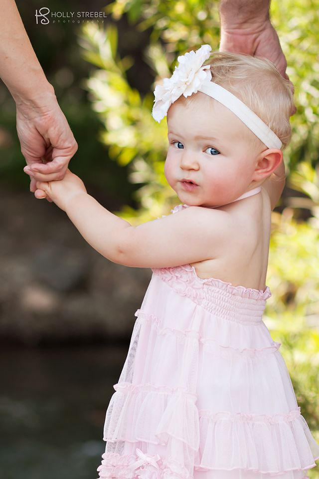 Picture idea #5. Also want to do her one week photo and one year photo holding mine and Daddy's fingers.
