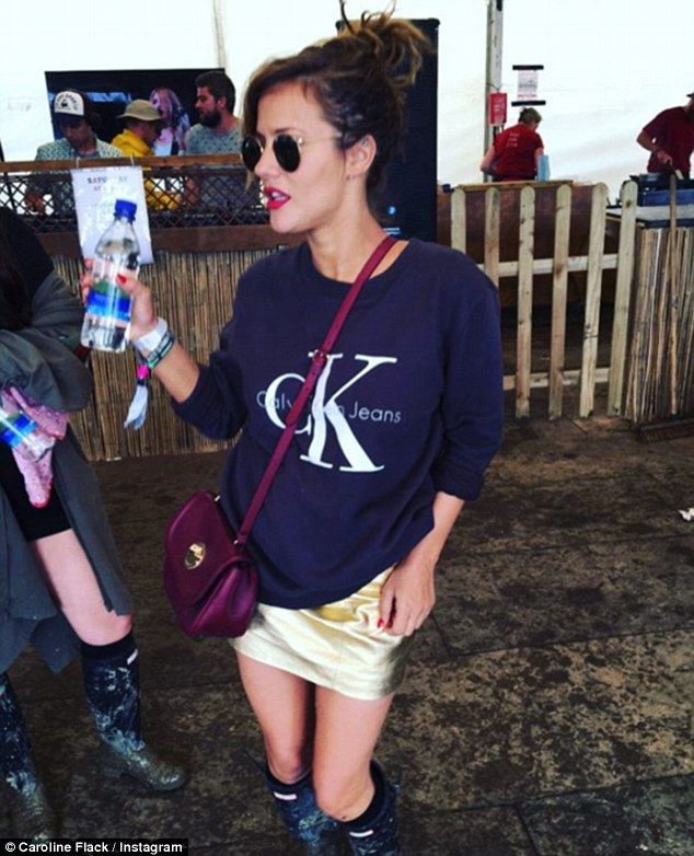 Music lover: Caroline Flack, 36, stepped out in a Calvin Klein sweater and gold suede skirt at the Glastonbury music festival in Somerset